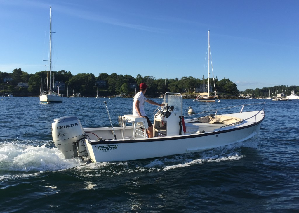 The Eastern 19 Center Console with dodger folded down, crossing Boothbay Harbor